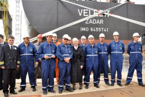 Rijeka, April 14 2011 - shipyard workers accompanied by Prime Minister Kosor taking photo for the memories in front of tanker